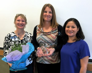 Paula Stefani, left, and Cynthia Pardo, right, recognize Ruth Ellen Elinski as a 2015 First Things First Champion for Young Children in the Coconino Region.