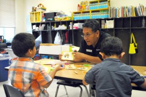 United Way of Northern Arizona President & CEO Steve Peru reads to children during a KinderCamp program. Courtesy photos.