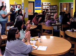 School administrators, teachers, staff and guests celebrate Killip's Out of School Time Excellence Award.