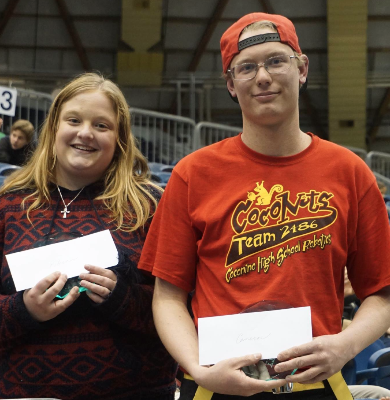 Rebecca Adams and Cameron Emry display their STEM Student of the Year plaques during the Flagstaff Community STEM Celebration at NAU. Photo courtesy of FUSD.